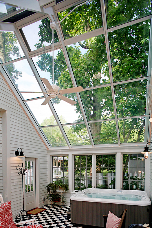 Grids enhance this sunroom that includes a straight eave, double skylight with no gable ends.