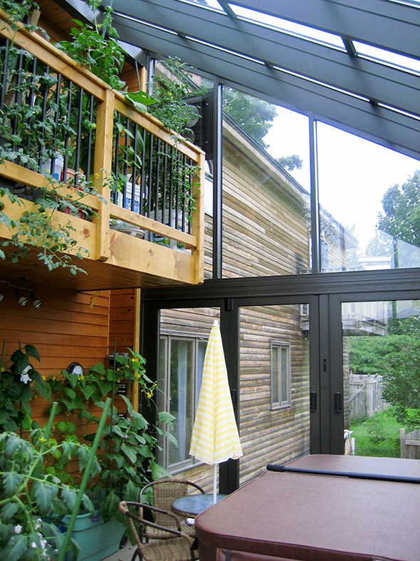 Curved Eave Lean-to spa enclosure, used to protect the customer's spa from the elements.