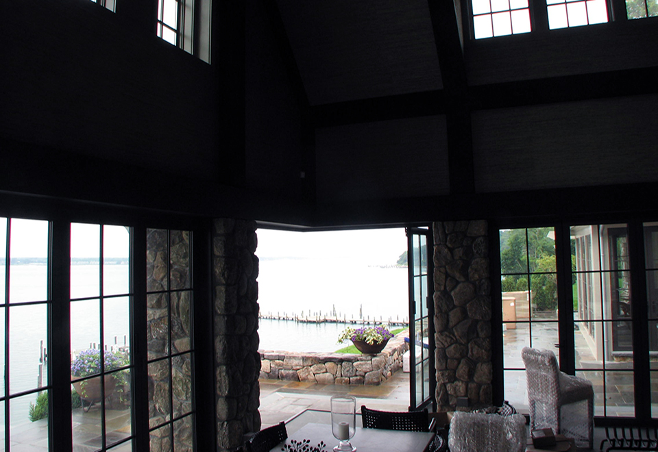 A guest house utilizing multiple folding glass walls, sliding doors, fixed windows and French doors.