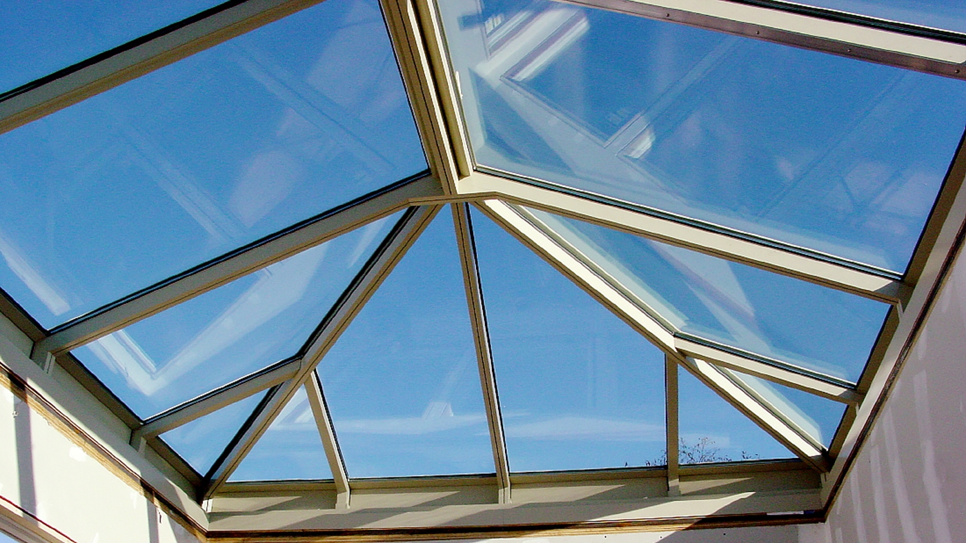 Straight eave double pitch hip end skylight