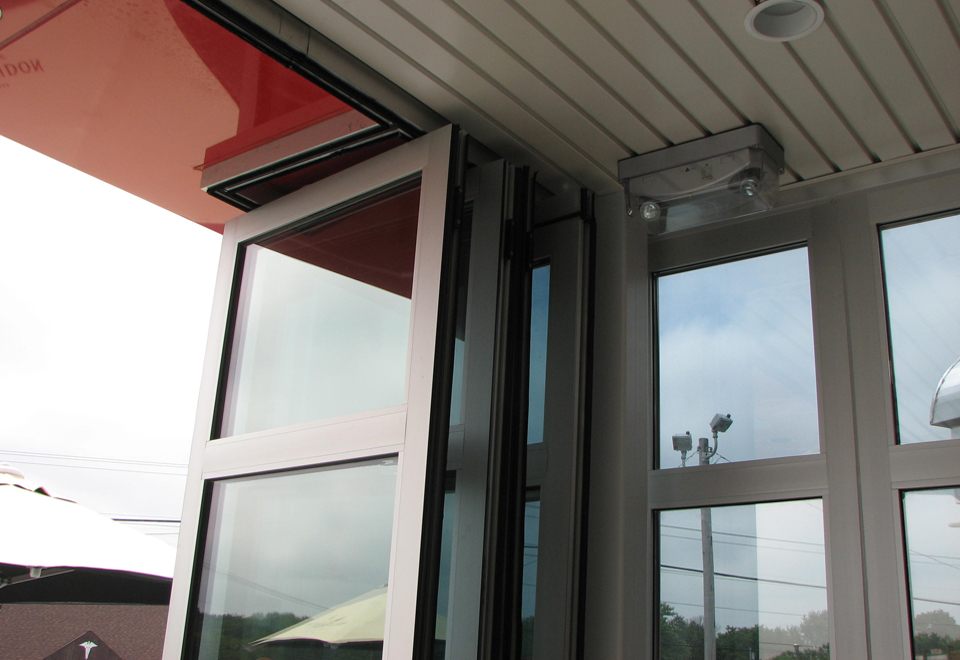 Folding glass wall system featured in clear anodized frame finish with 272 glass.