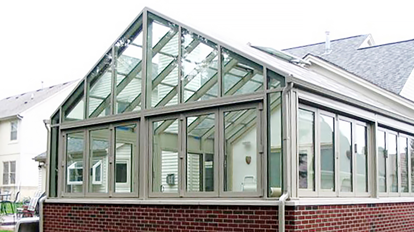 Straight eave double pitch pool enclosure with ridge vents, folding windows, a folding wall and a sliding door system.