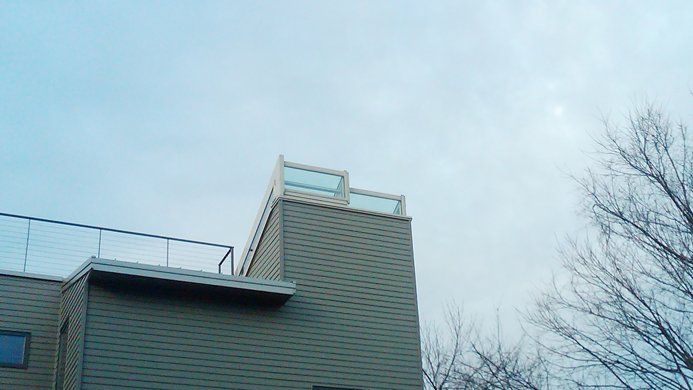 Manually operable straight eave lean-to skylight