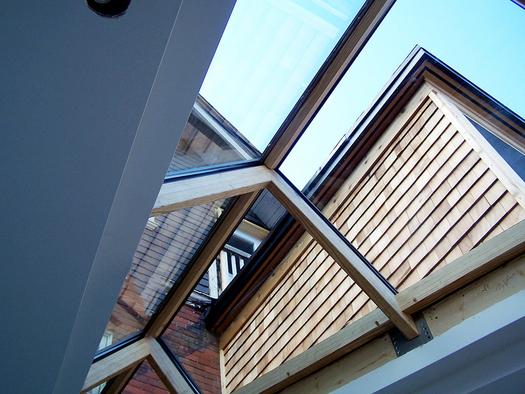 Irregular straight eave double pitch skylight with 0 gable ends and southern yellow pine interior.