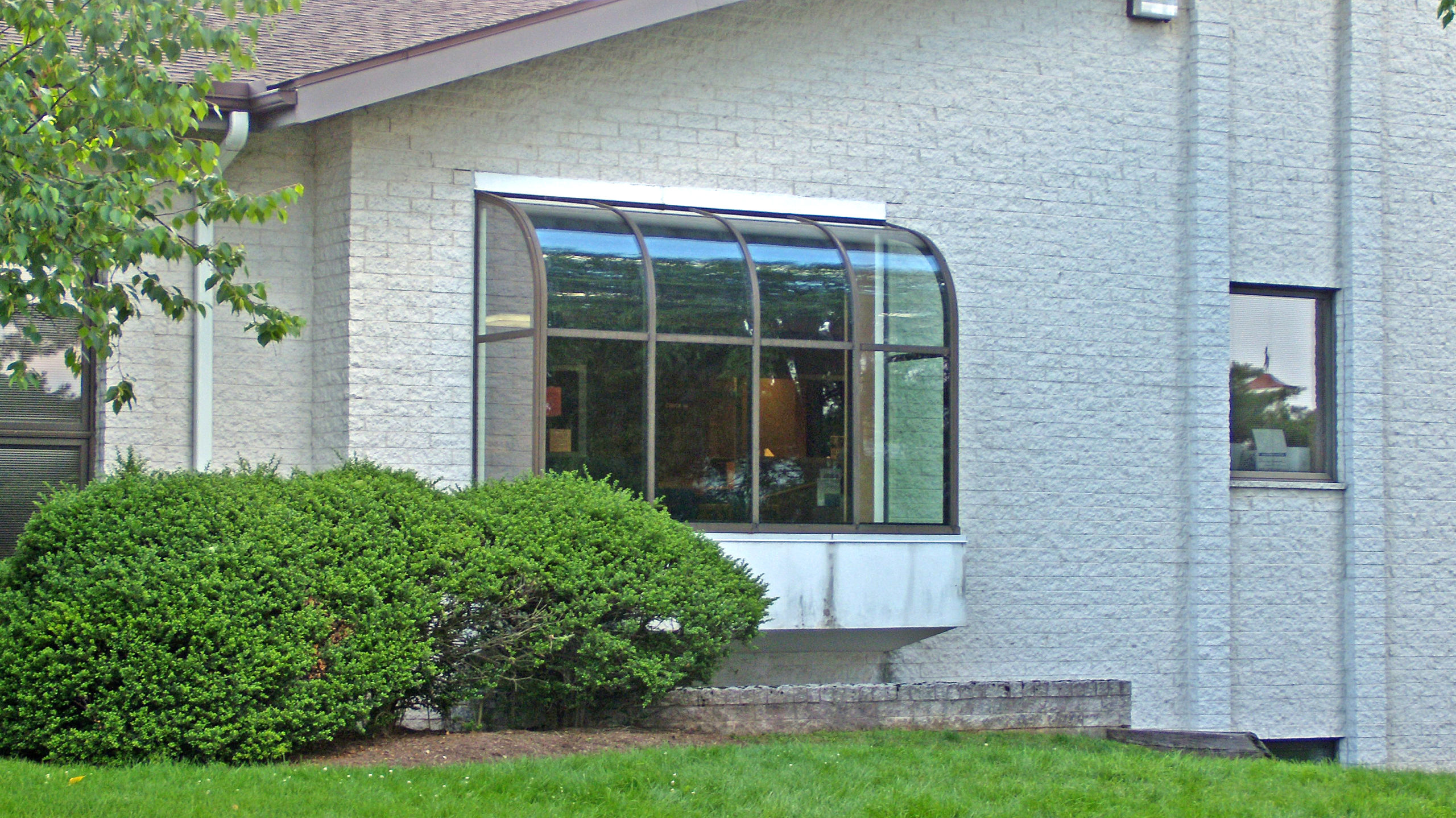 Curved eave lean-to sunroom.