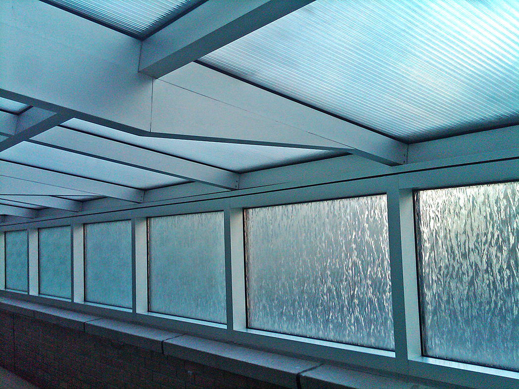 Retractable roof skylight with polycarbonate glazing.