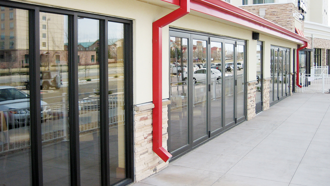 Two folding glass wall systems, both are all wall configurations, with panels folding to the left, and a standard sill.