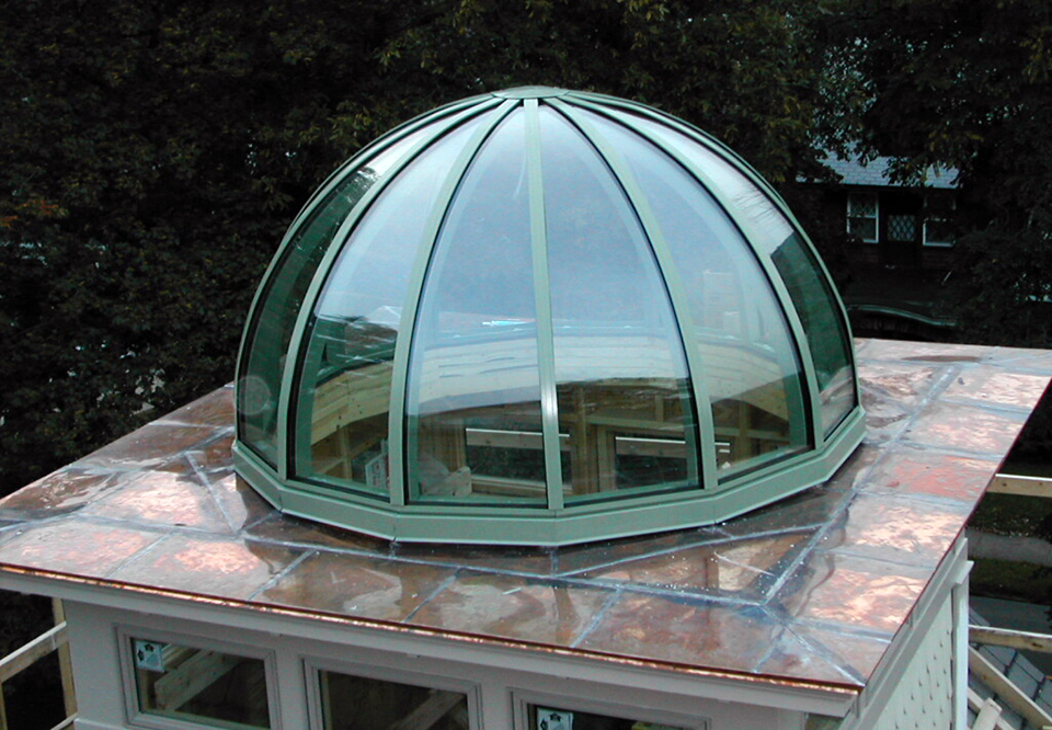 Fourteen sided dome skylight with copper clad exterior.