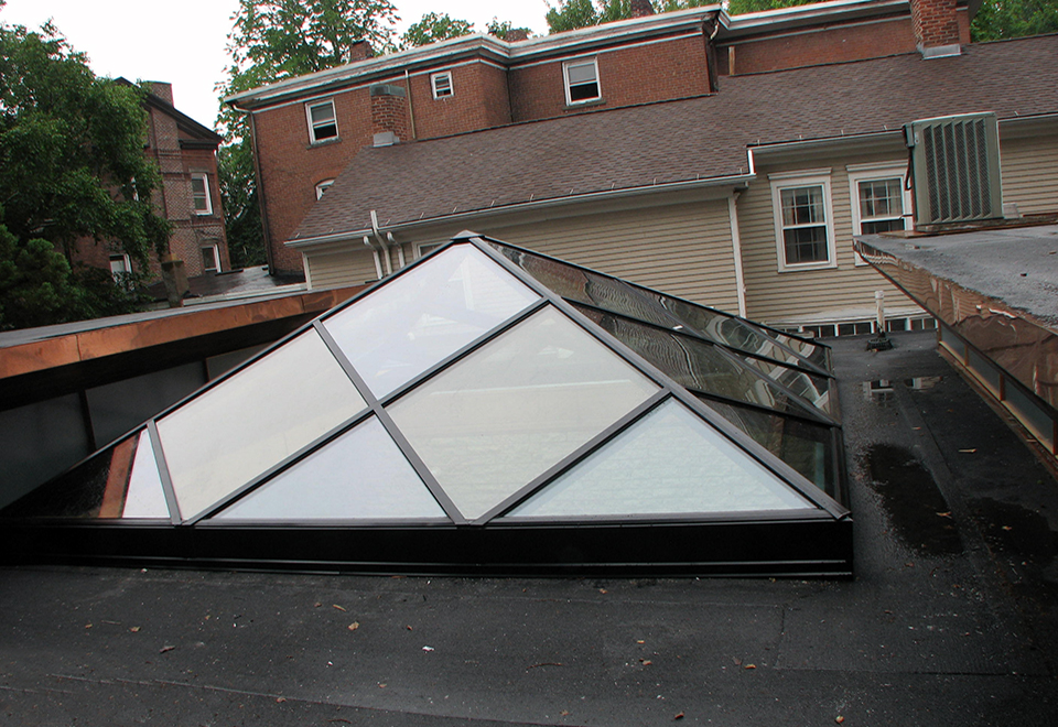 Welded curb pyramid skylight.