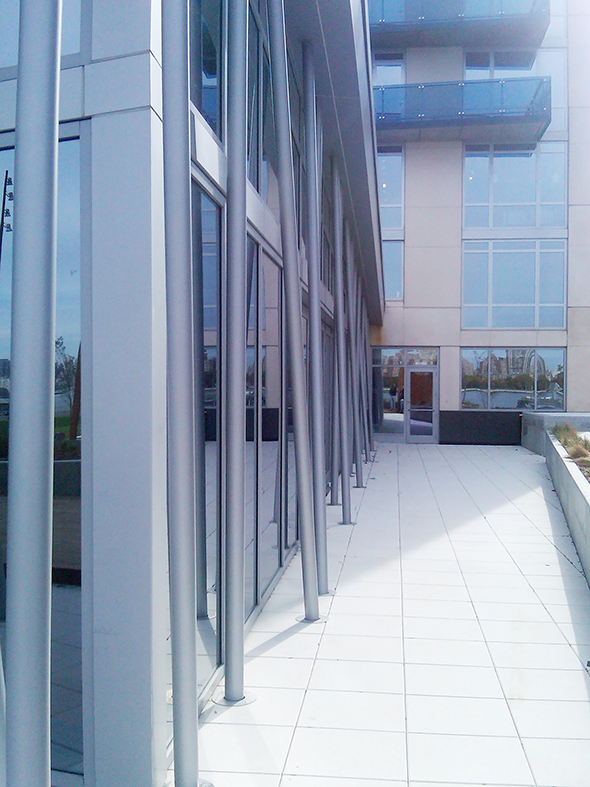 Three stacking glass wall systems used in a pool enclosure. Each unit uses a surface mount sill, specialty glazing and a custom frame finish.