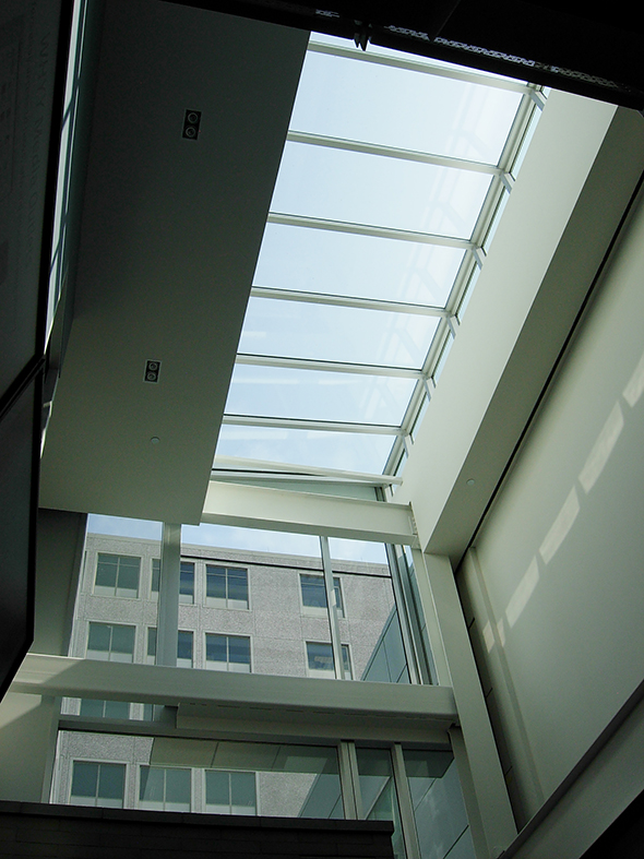 Straight eave lean-to skylight with one gable end, two return walls and one rear wall