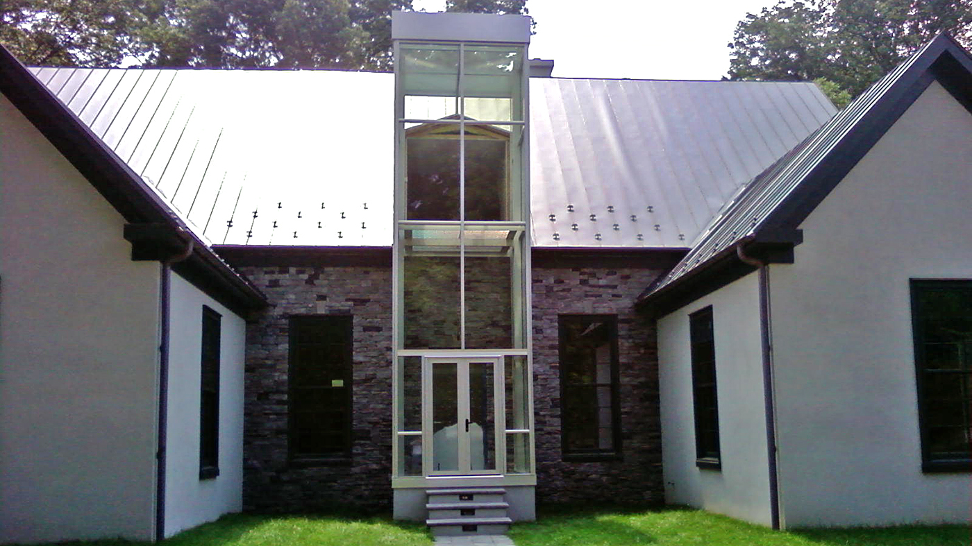 Straight eave lean-to tower with rear wall and partial front wall to connect to existing dormer roof.