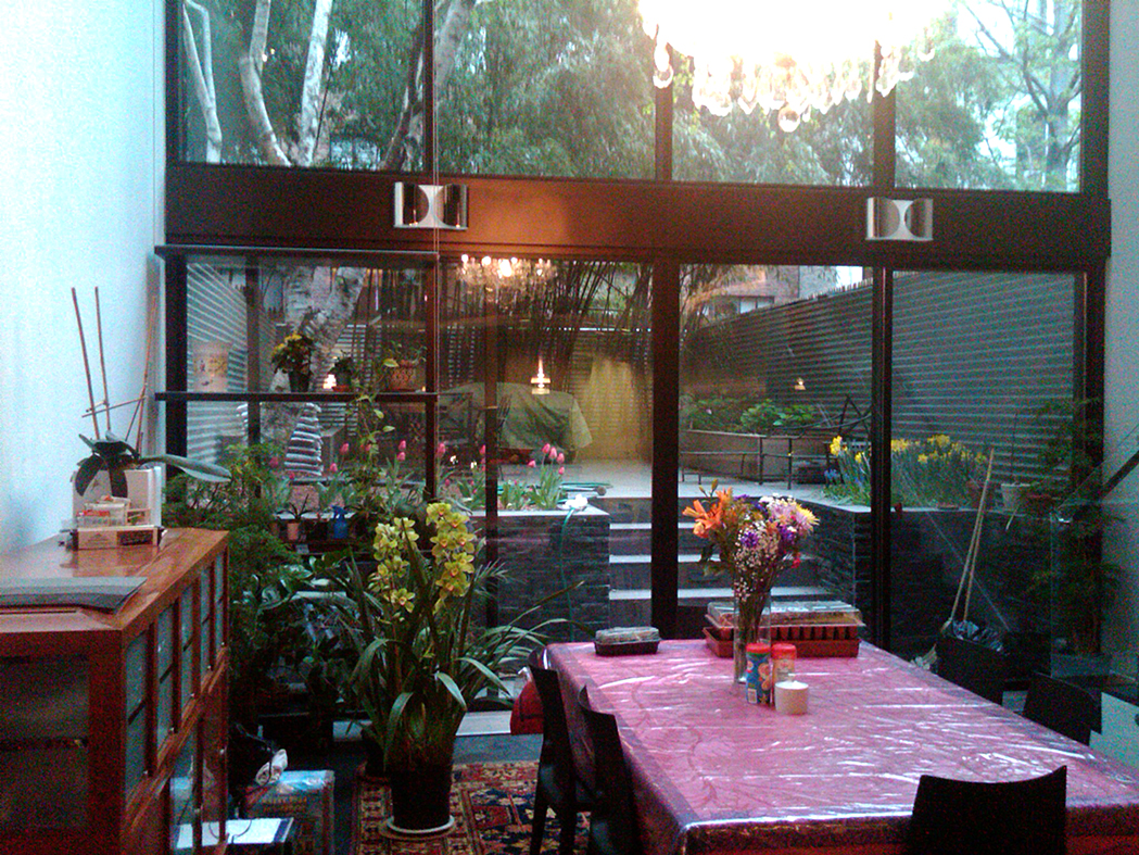Multi-track sliding glass door with screens.