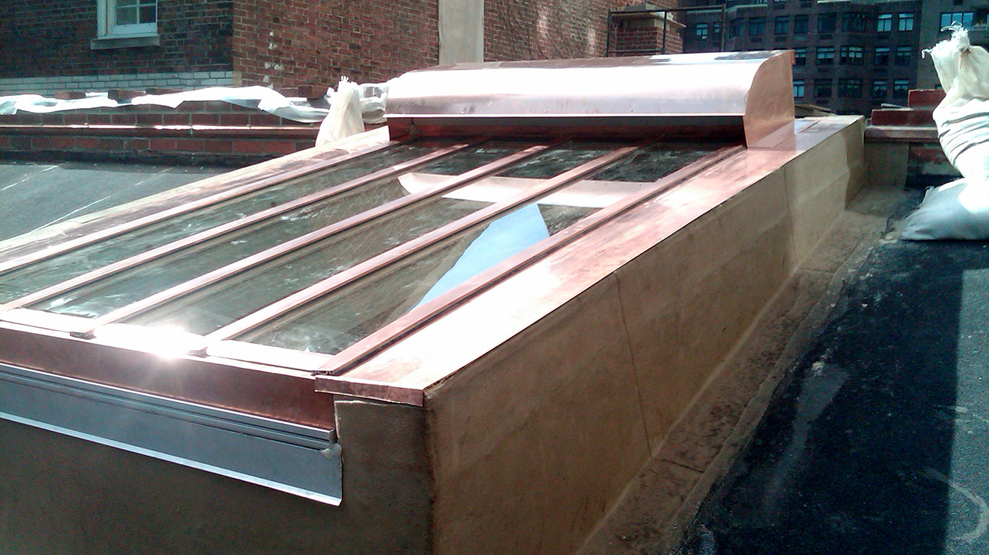 Copper clad single slope skylight with air intake