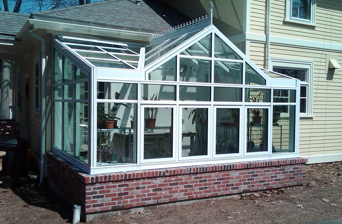 Straight eave lean-to greenhouse with 2 gable ends and straight eave double pitch dormer.