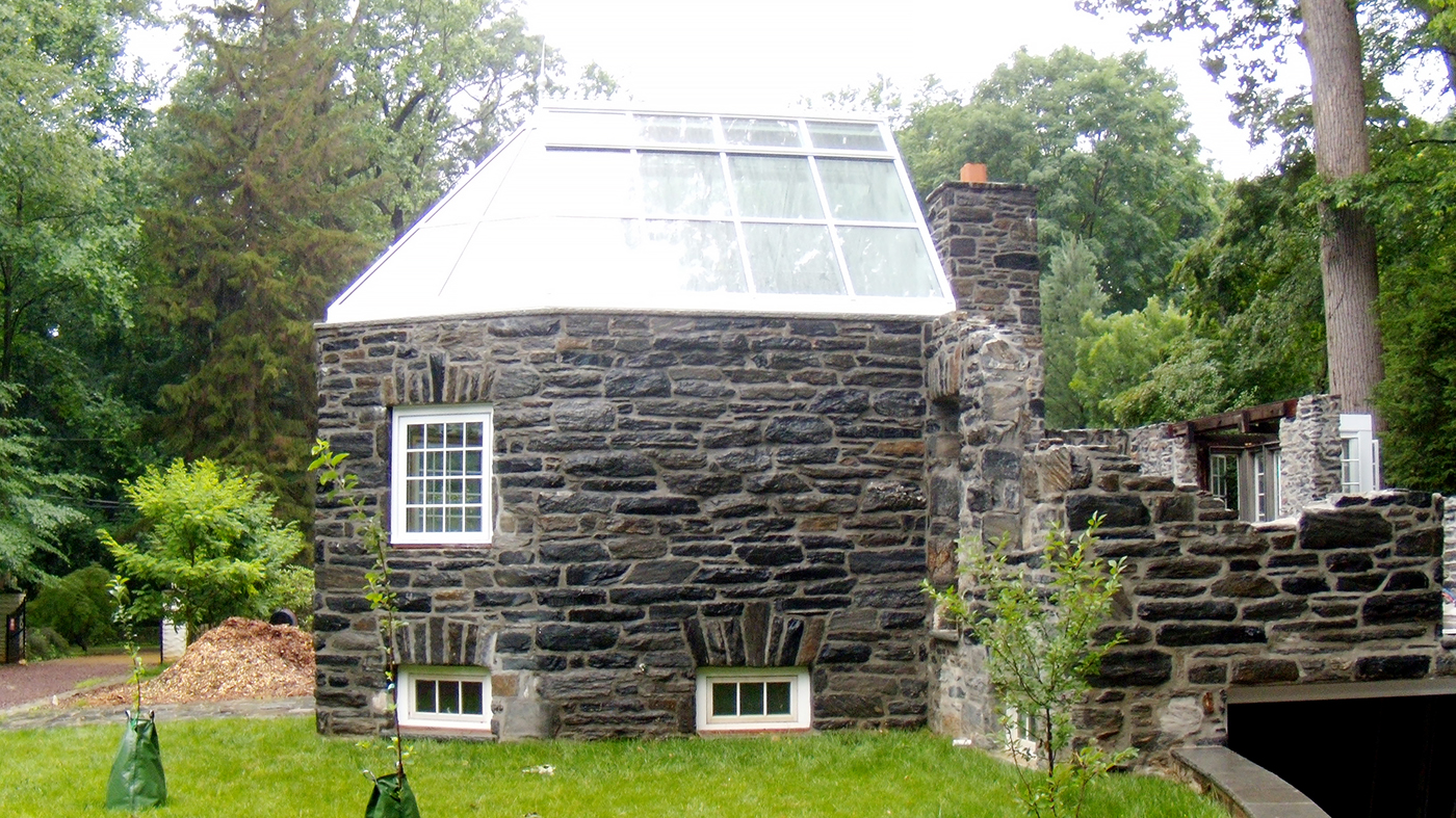 Straight eave double pitch skylight with irregular conservatory nose and one full gable end to ground level.