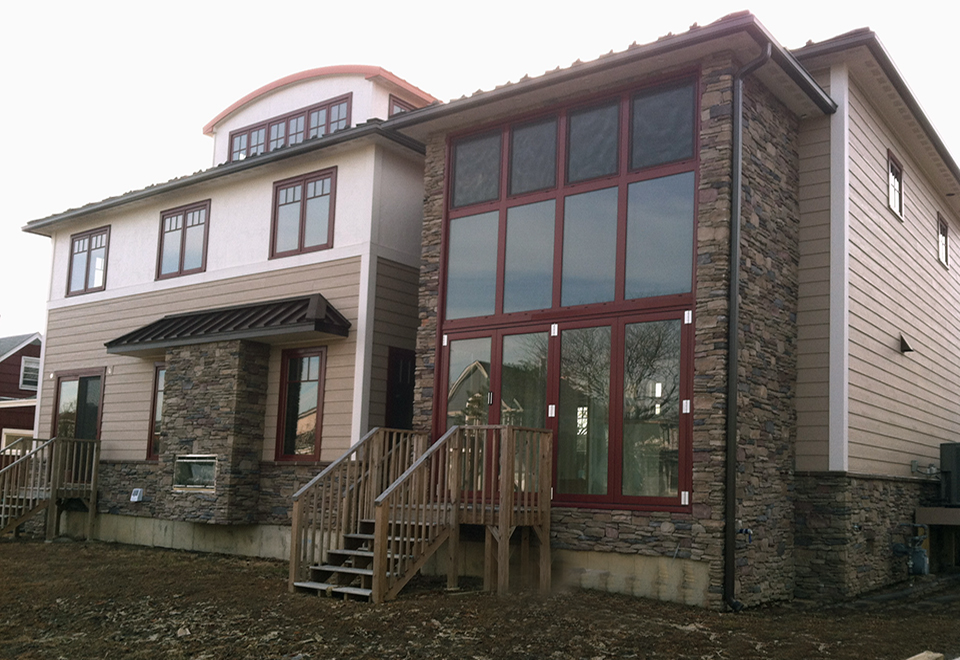 Residential curtain wall utilizing the European system, with integrated tilt turn windows, folding doors and operable screens, along with a terrace door.