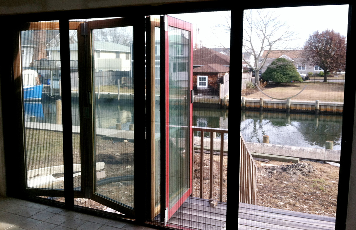 European window all system with integrated bifold doors and inswing casement windows.