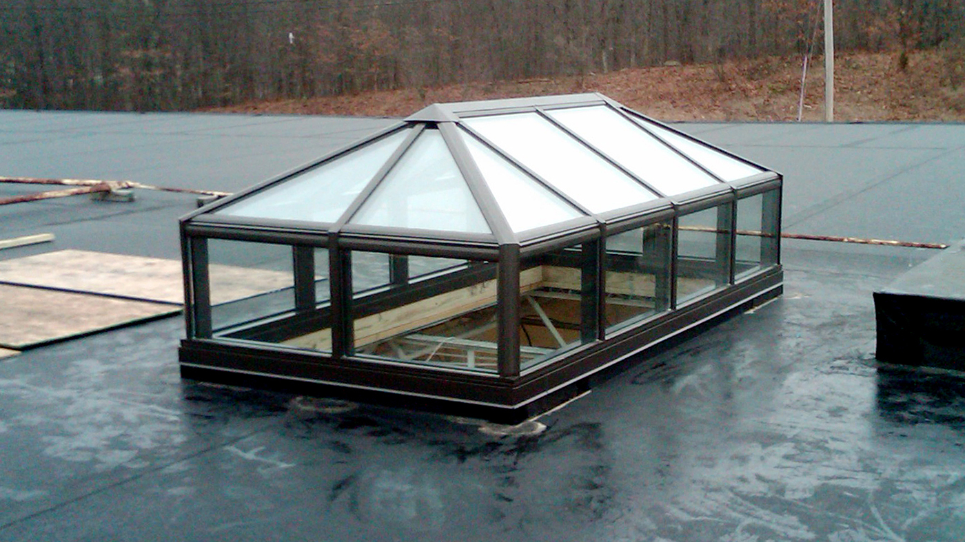 Straight eave double pitch lantern hip end skylight