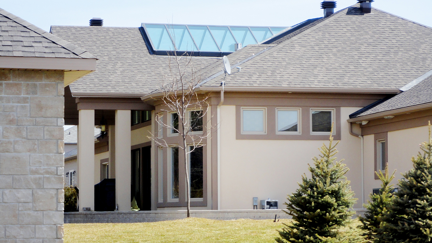 Residential home with two tone interior sliding doors, curtain wall, exterior sliding doors, folding window unit, and an irregular double pitch skylight.