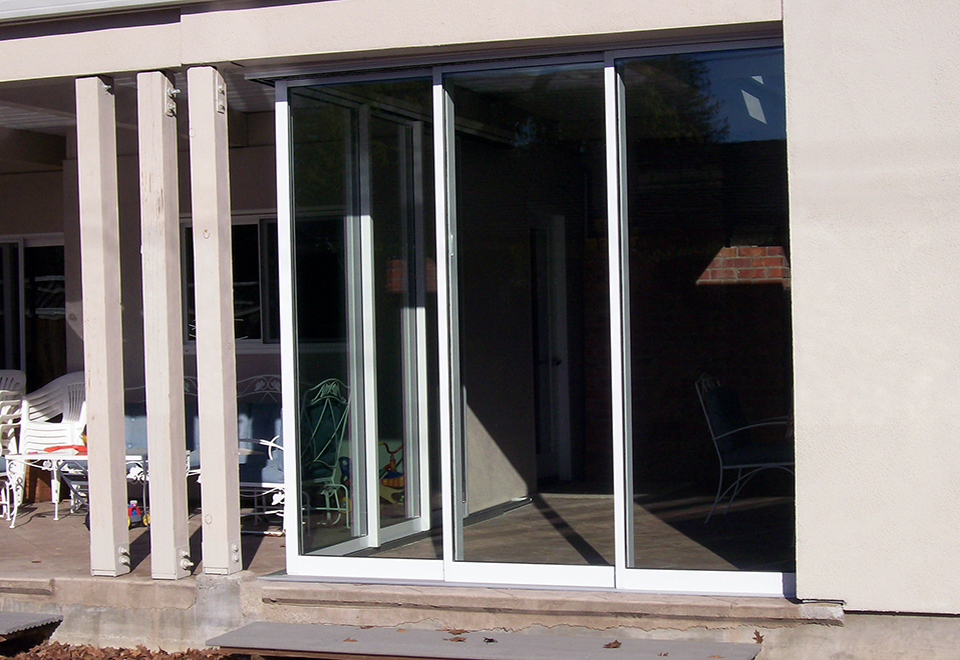 Two multi-track sliding door systems meeting at a no post corner.
