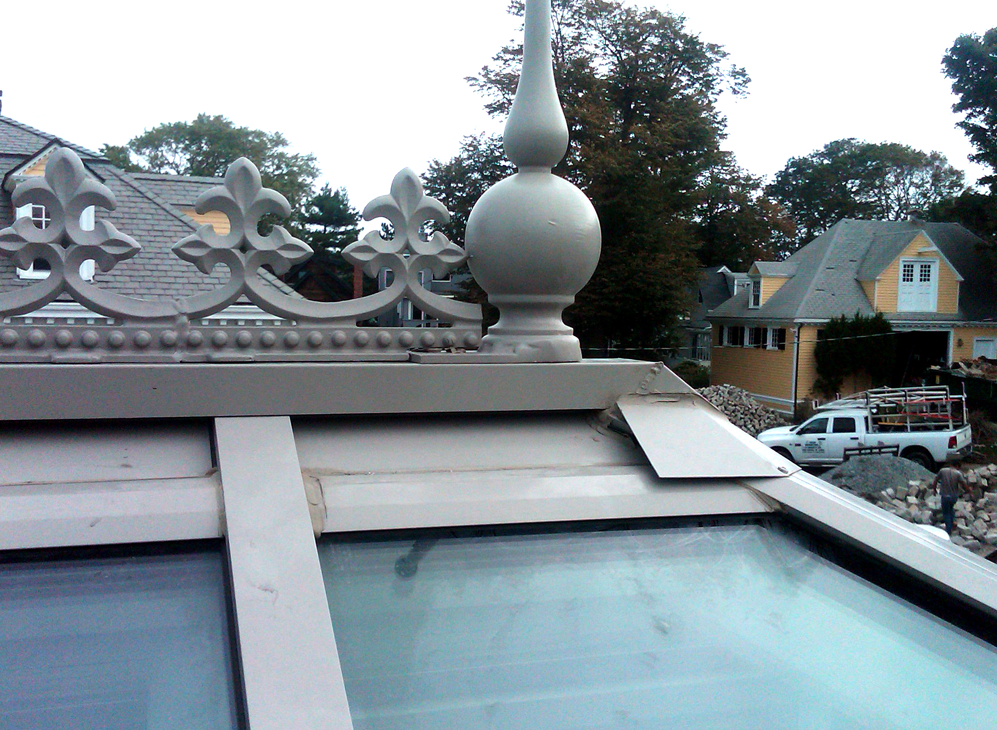 Custom / irregular conservatory featuring a dormer and lantern. Decorative elements include: ridge cresting, finial, transom, base panel, palladian, crown molding, corner post, SDL, gutter, and downspout.