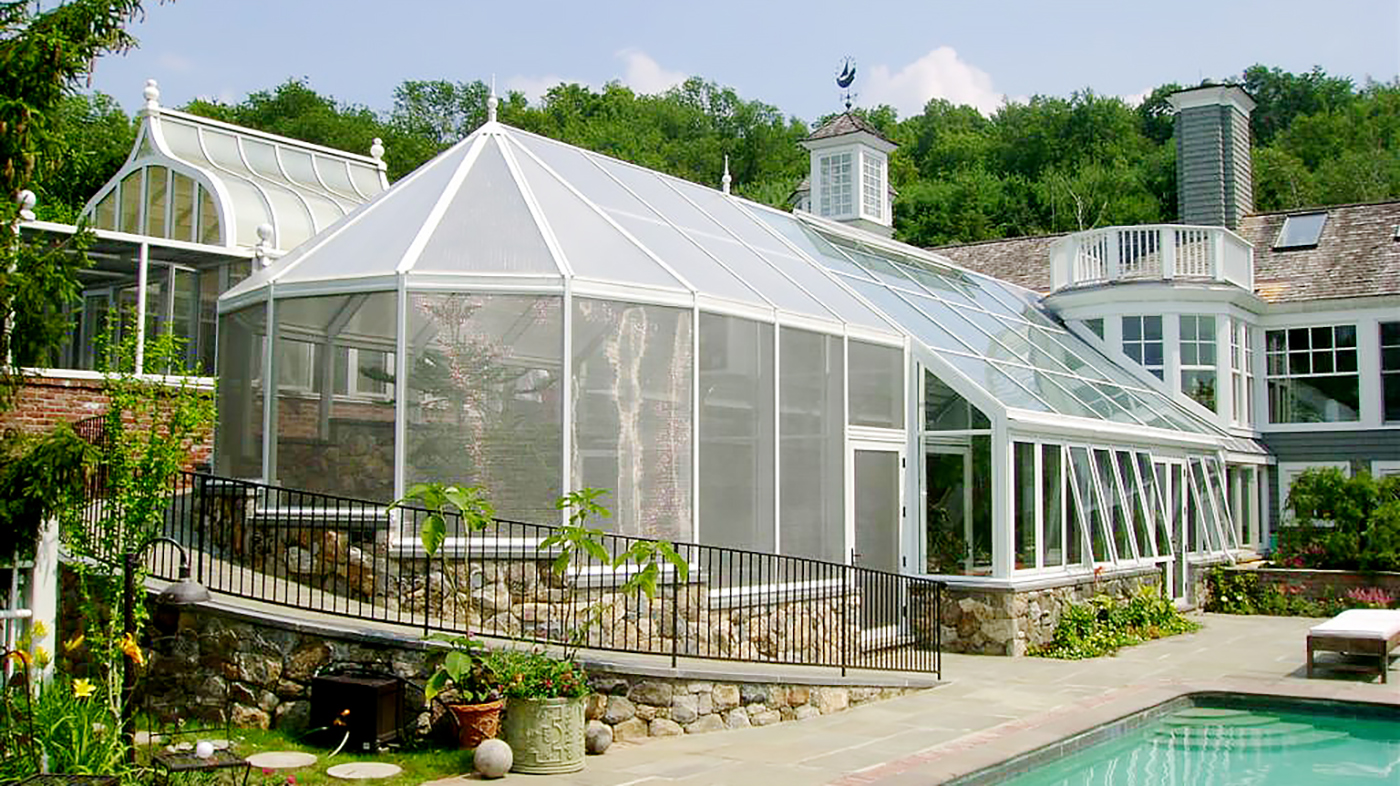 Straight eave double pitch conservatory with ridge vents and awning windows. The conservatory has an attached irregular conservatory nose conservatory with a stepped configuration used for raising turtles. The turtle conservatory uses specialty pet screen.