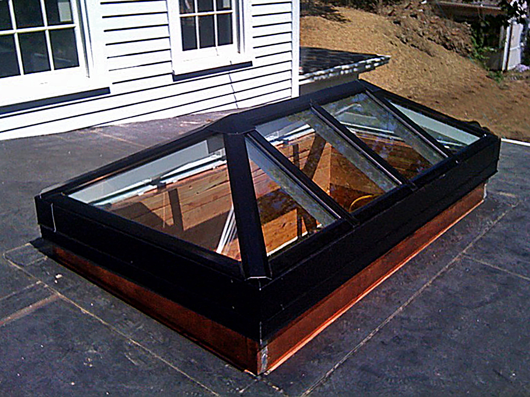 Straight-eave double pitch skylight.