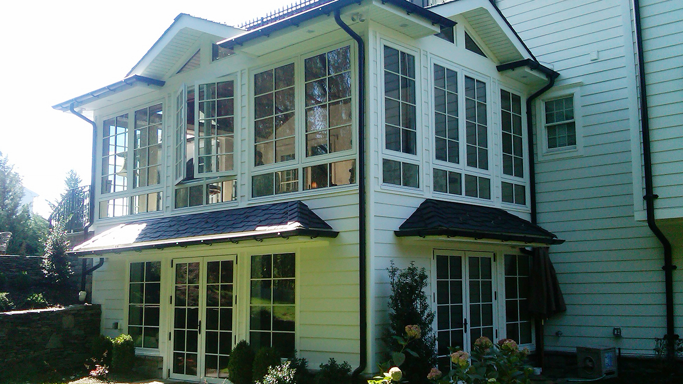Multiple European window/wall systems in one home. French doors, curtain walls and casement windows used in traditional construction. Units showcase SDL grids.