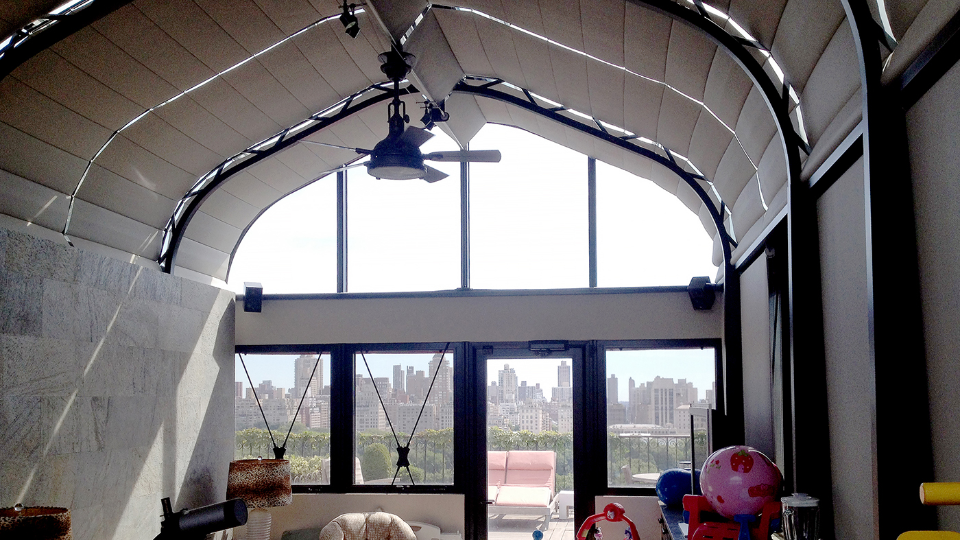 Curved Eave Double Pitch Sunroom(Ogee style) located in New York City's Central Park West District. NYC traffic was re-routed for install and the project was featured on DIY Network's