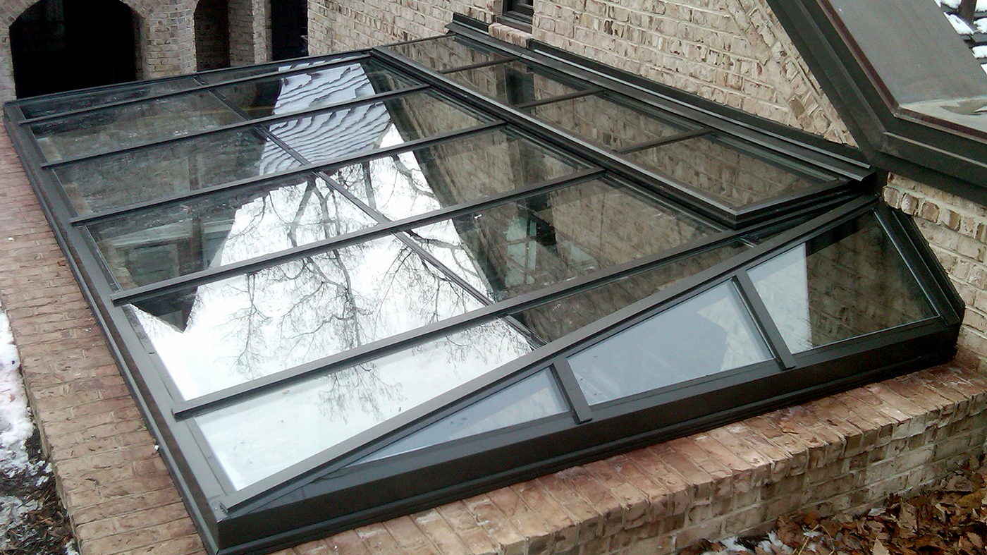 Straight eave lean-to skylight with a ridge vent