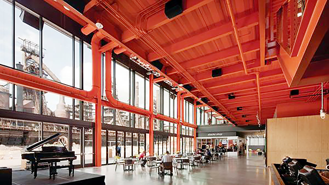 Folding Glass Wall (Mid Wall Split) in use at the Bethlehem Steel Stacks for dining and retail sales purposes.
