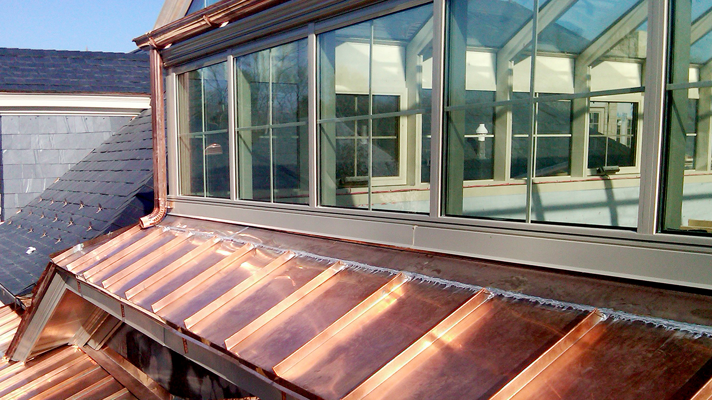 Straight eave double pitch skylight with gridded transom windows