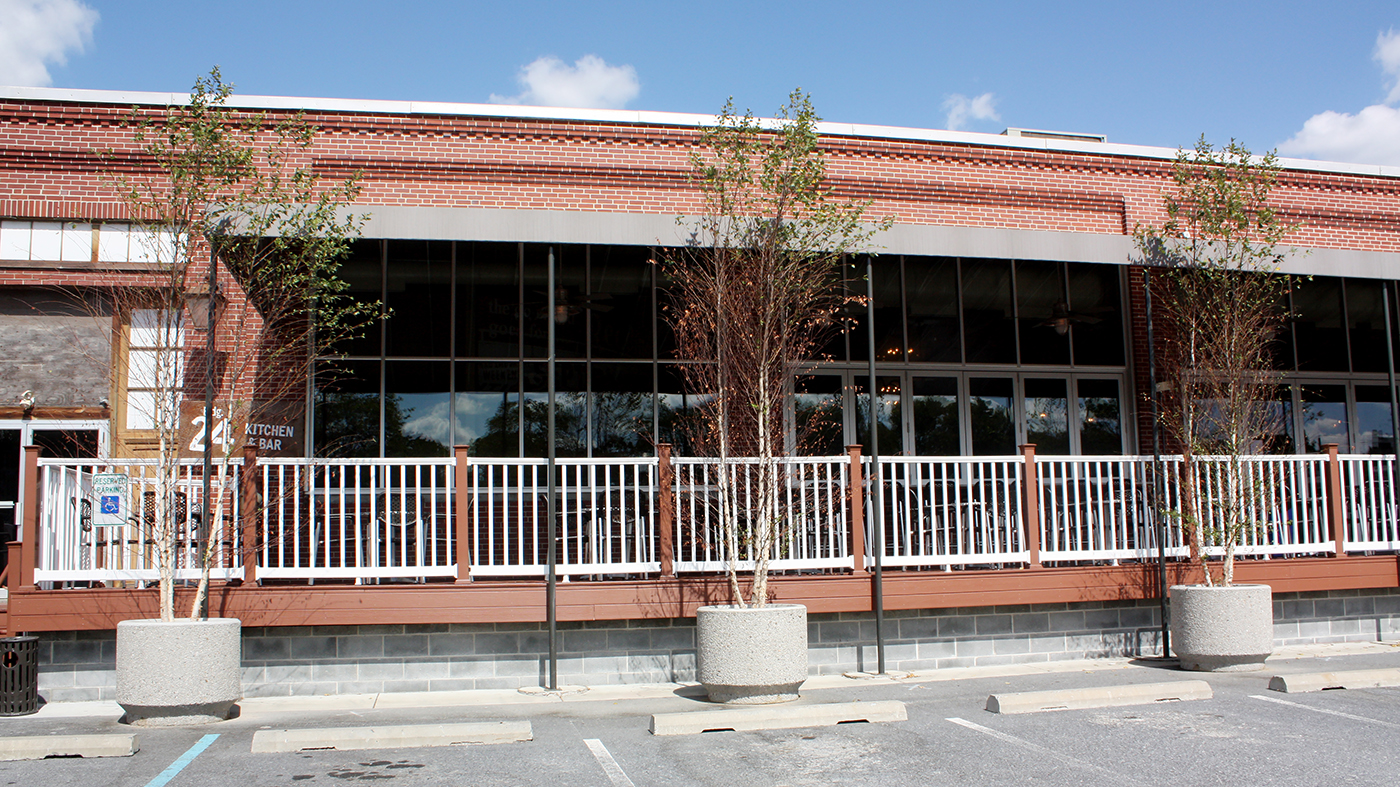 Restaurant exterior consisting of folding windows, terrace door, curtain wall and transoms.