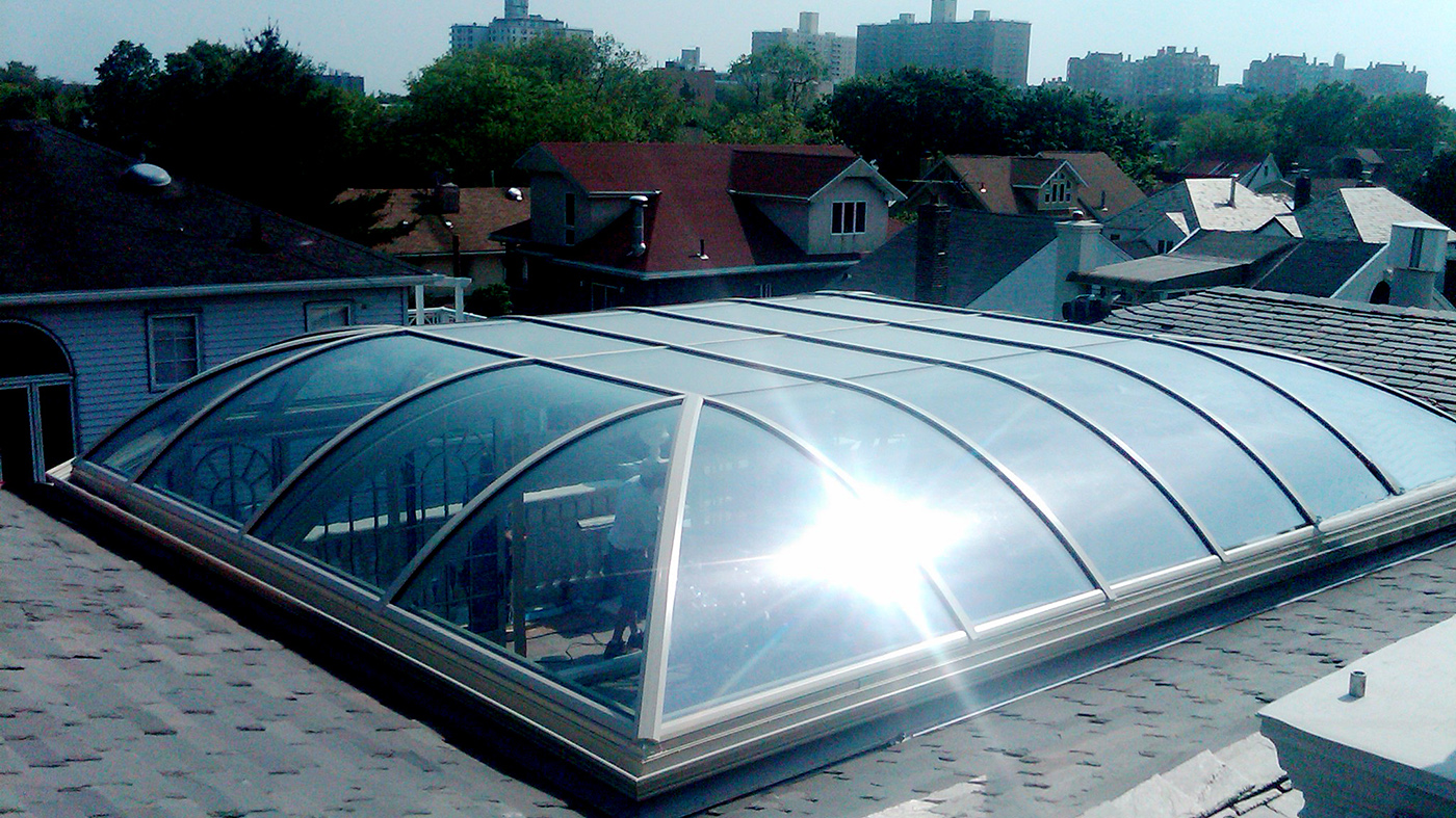 Curved eave pool enclosure with sliding glass doors