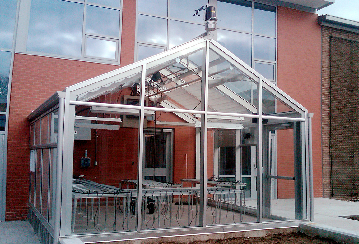 Straight eave double pitch gable end greenhouse with environmental control system and weather station