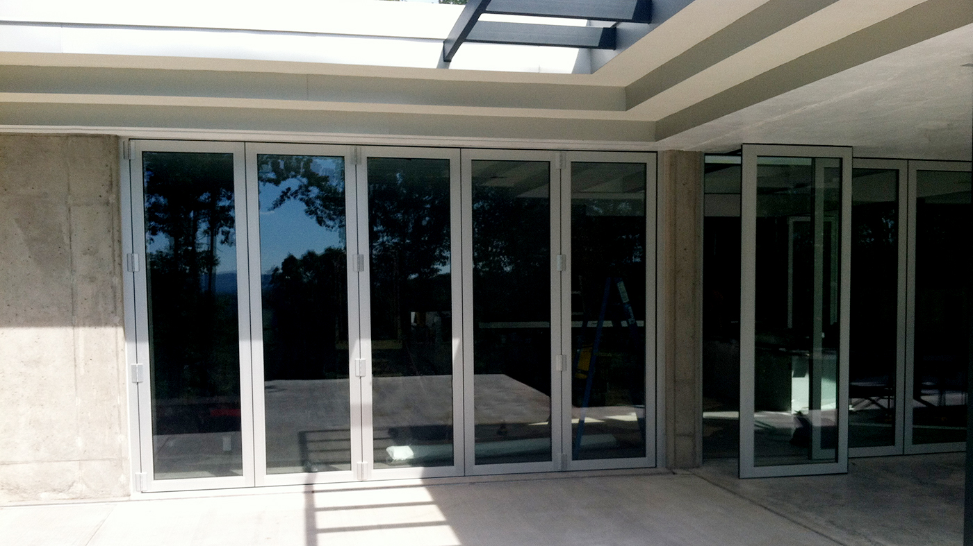 Whole house glazing project where the residence used terrace doors, stack walls, folding glass doors, awning windows and curtain walls.