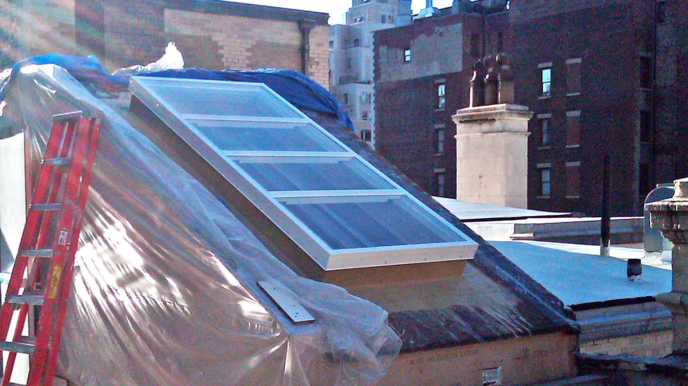 Flat welded curb skylight and straight eave double pitch skylight.