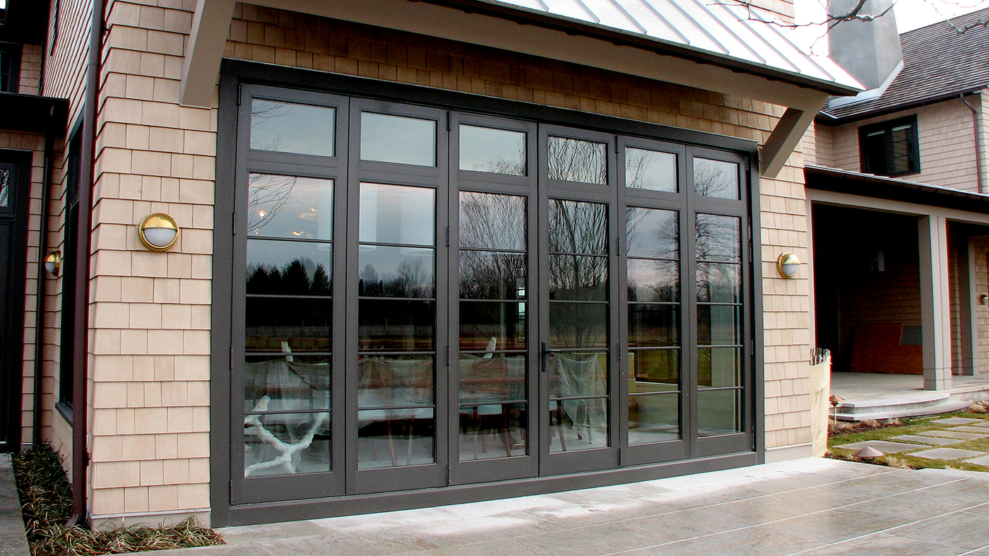 Complete glazing package including folding glass walls, dual track sliding glass doors, terrace doors, and windows.