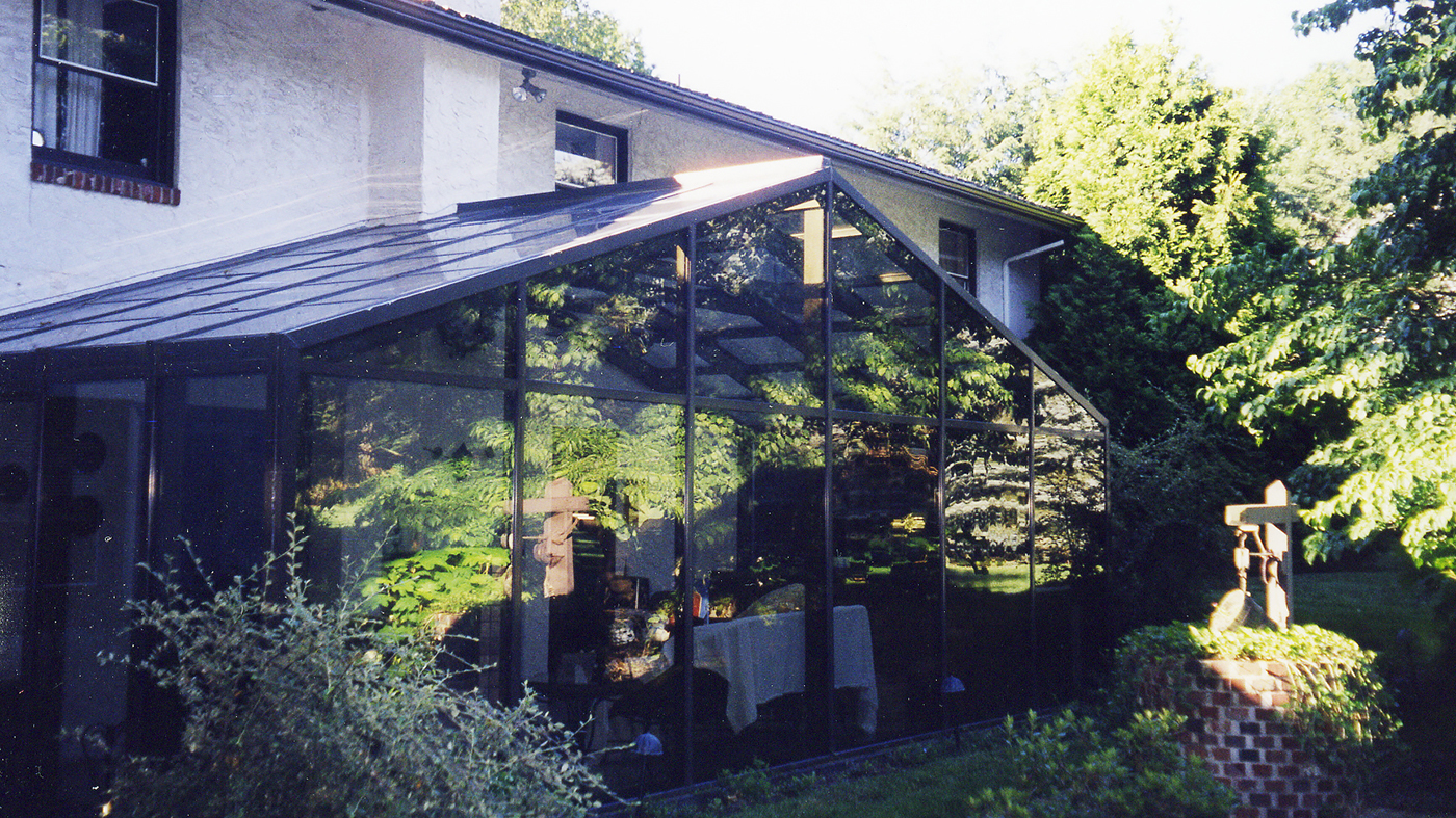 Residential Straight eave double pitch sunroom.