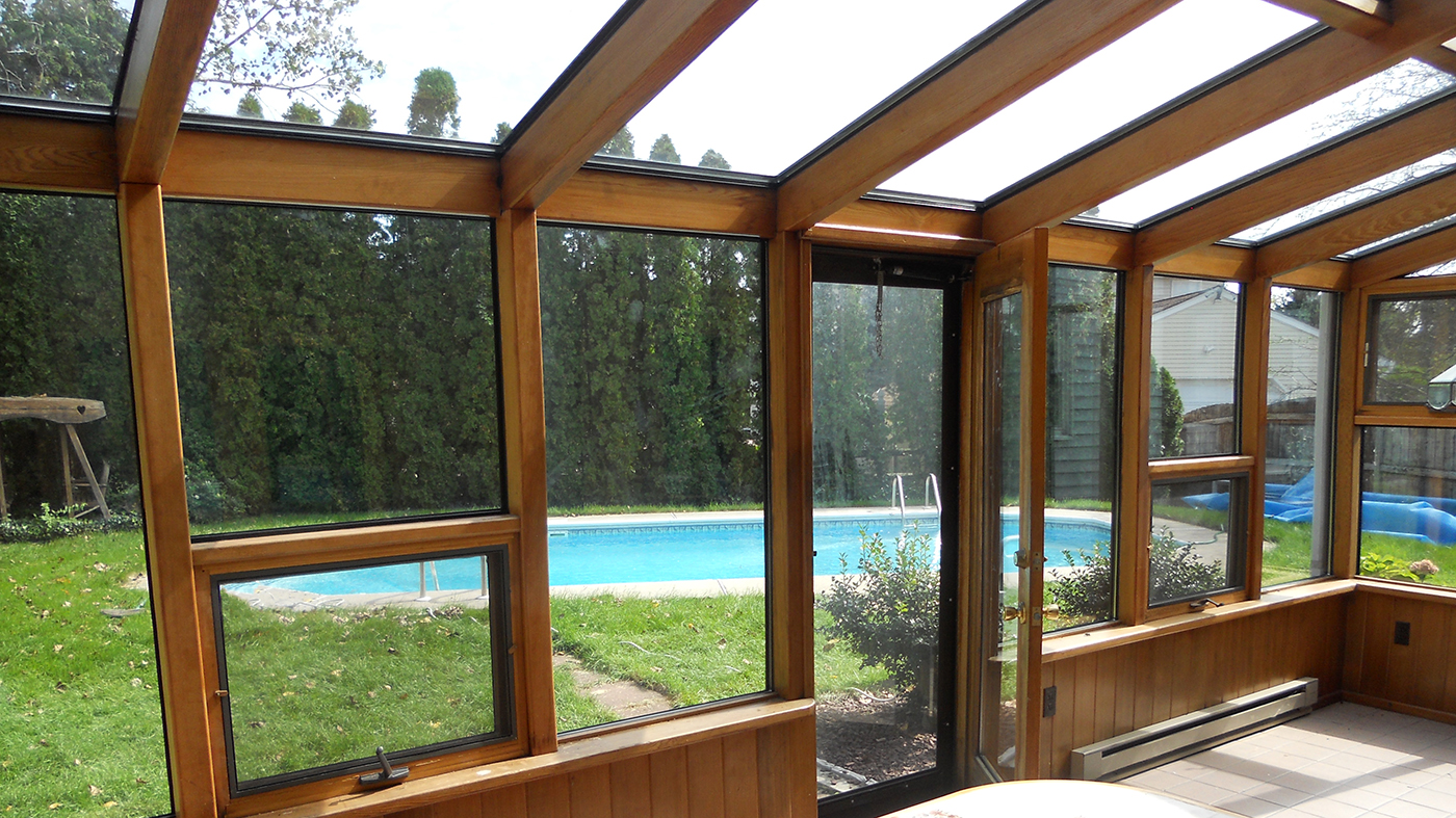 Flexible glazing system applied to an existing wood sunroom members.