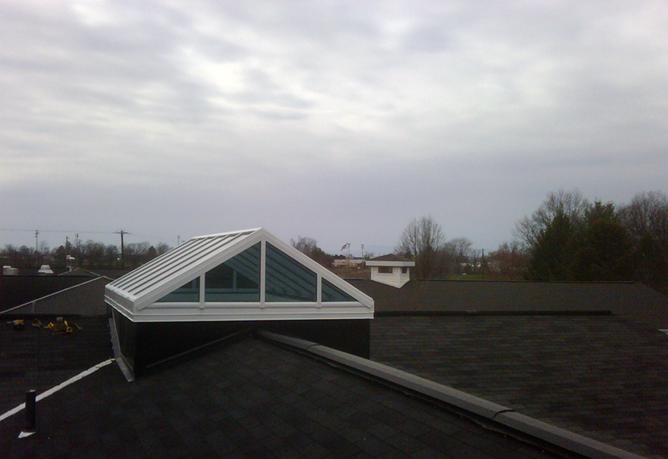 Straight eave double pitch skylight with two gable ends.