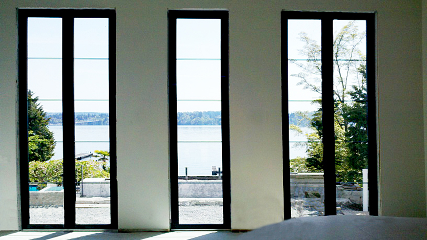 Two sets of French doors flank a fixed window
