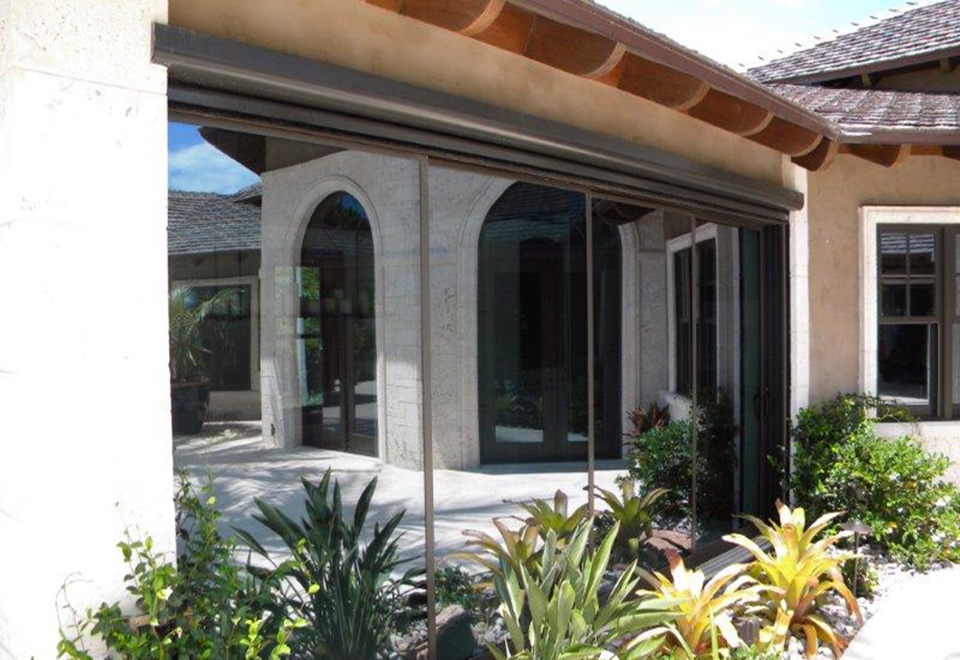 Two multi track sliding glass doors and a 90 degree no post corner folding glass wall system.
