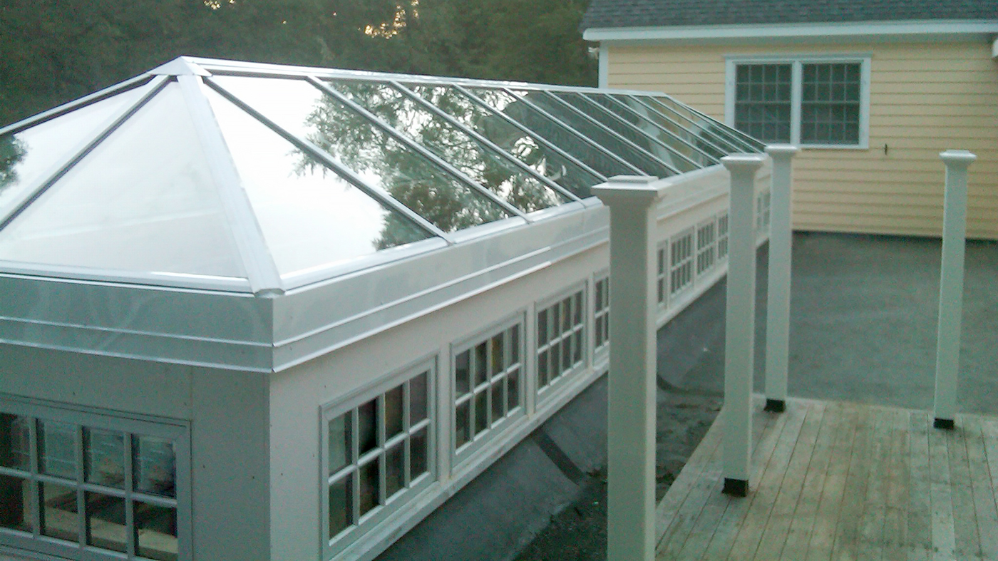 Straight eave double pitch skylight with two hip ends, and a pyramid skylight.