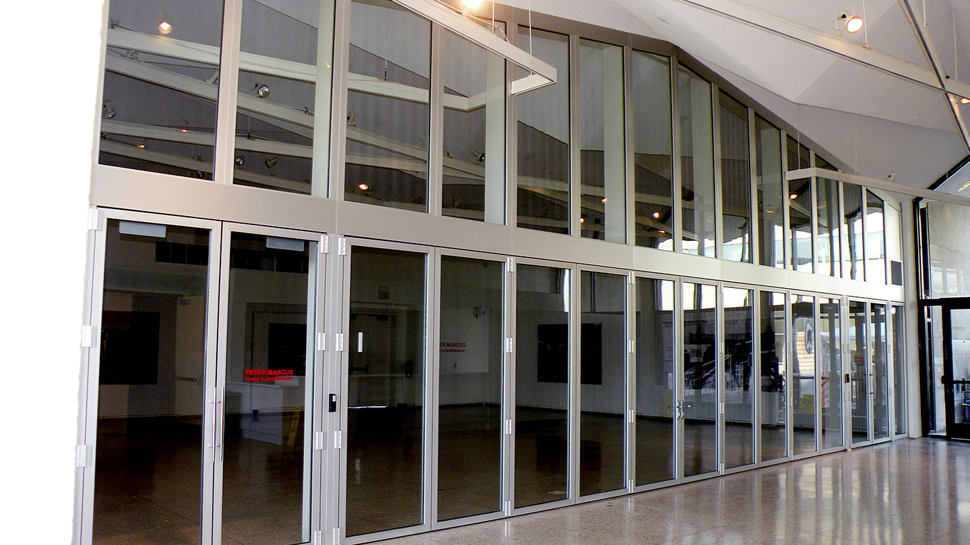 One bifold door system and two sets of French doors incorporated into an aluminum curtain wall