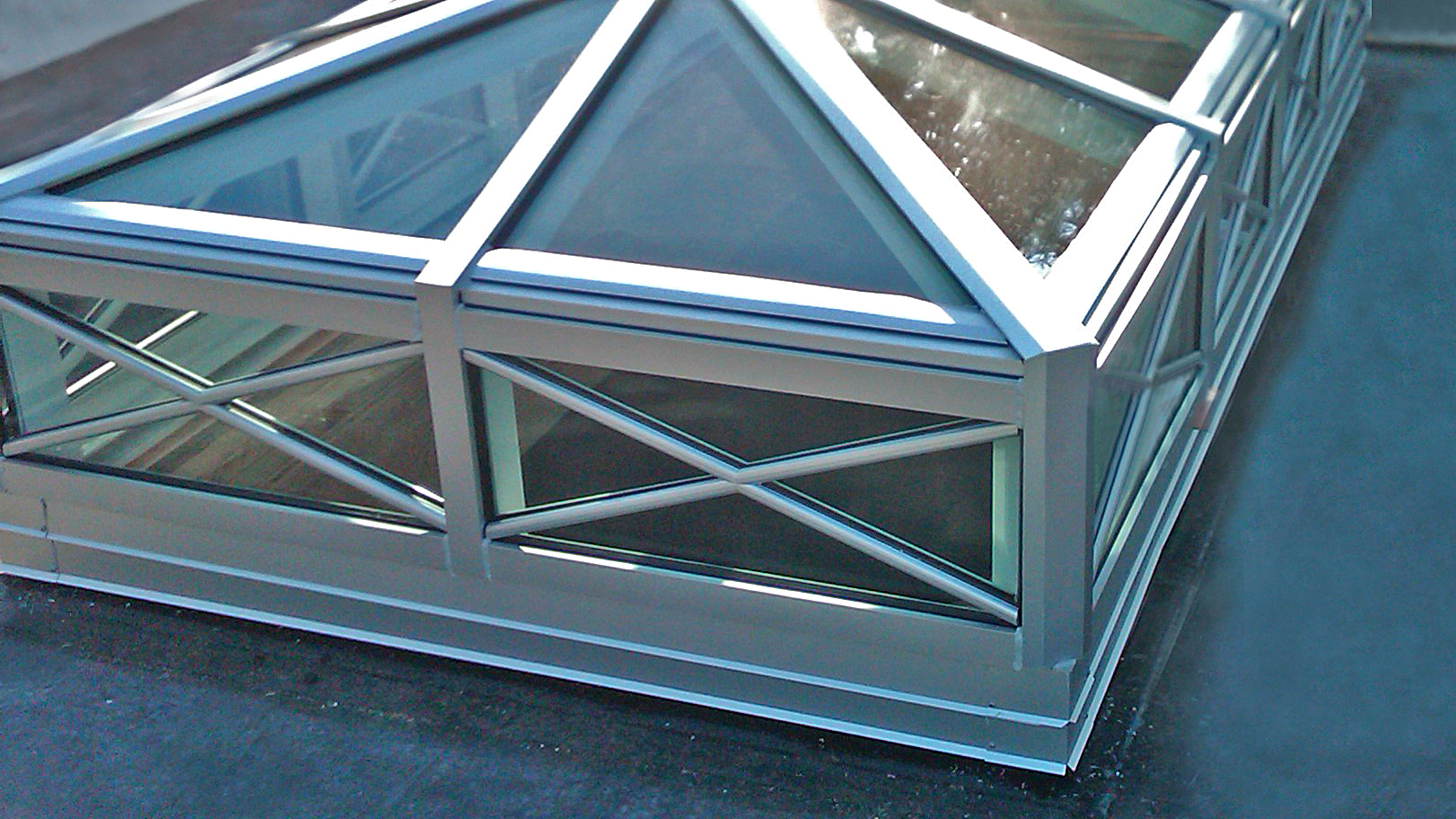 Double pitch skylight with two gable ends and transom.