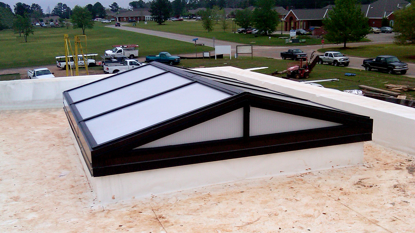 Straight eave double pitch skylight with polycarbonate infill