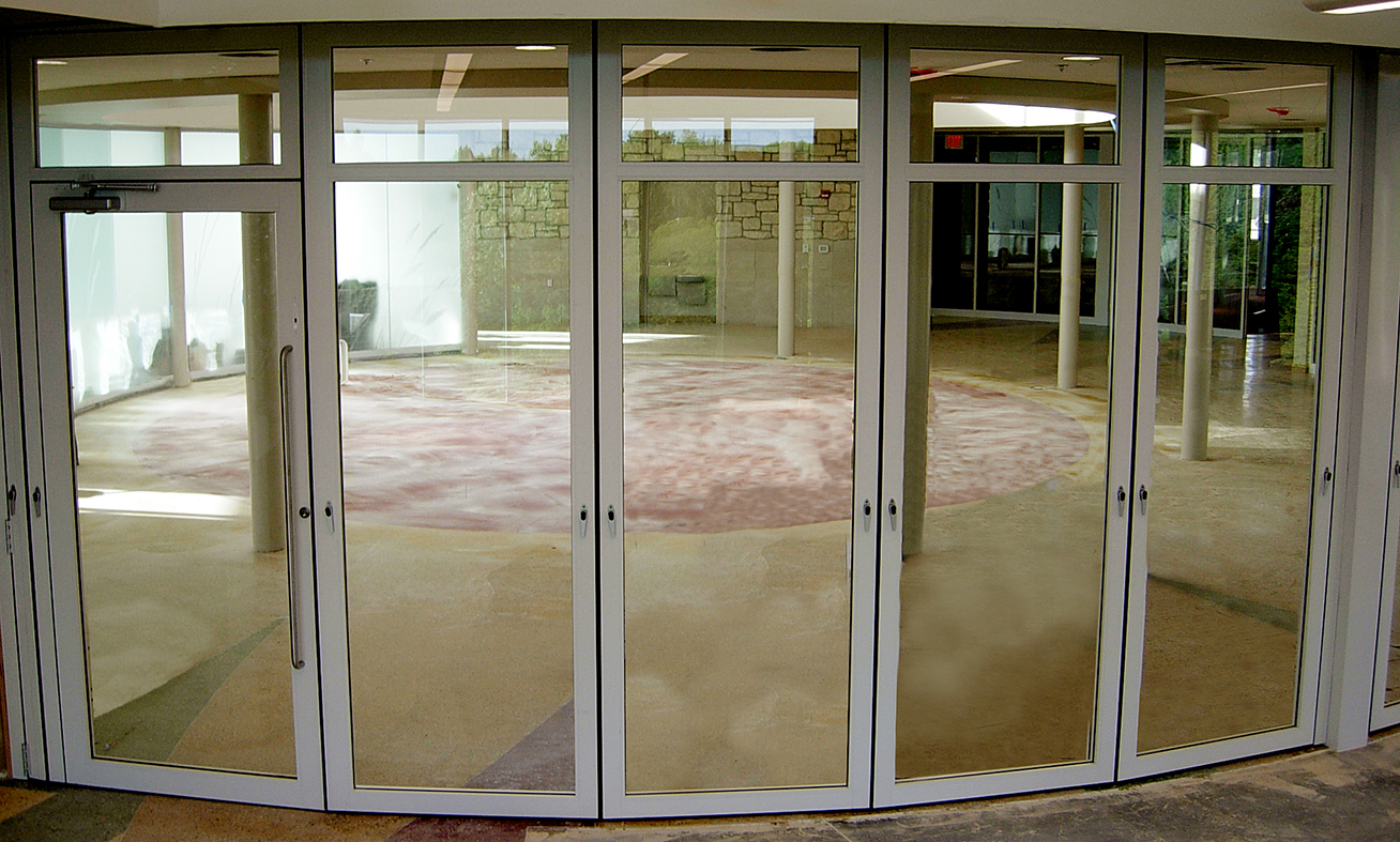 Segmented radius slide and stack doors