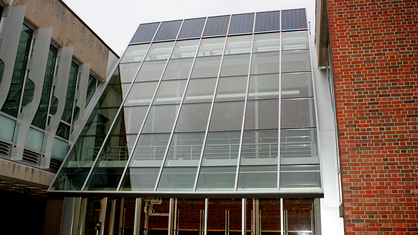 Straight Eave Lean To Greenhouse with solar panels incorporated into the design